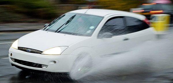 car aqua planing in the rain