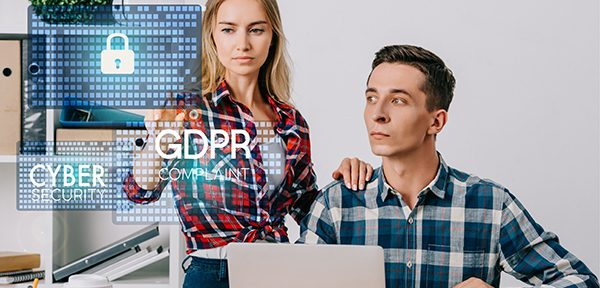 Man and woman in check-shirts seriously looking at emails after GDPR