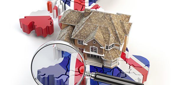 Mortgage represented by a magnifying glass on a house on a map with the British flag