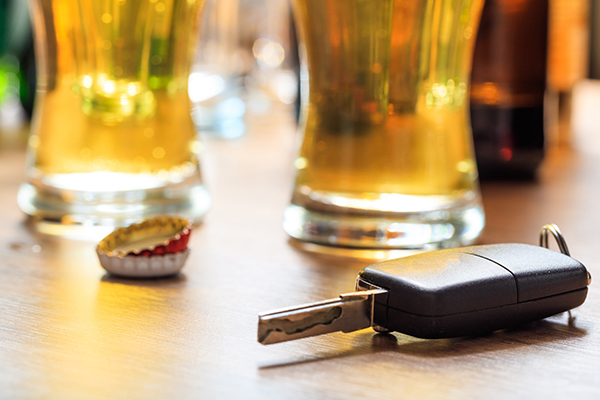 Don't drink and drive two pints of beer on a pub table with car keys and bottle tops