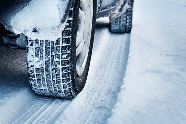 tyre close up on a snowy icy road