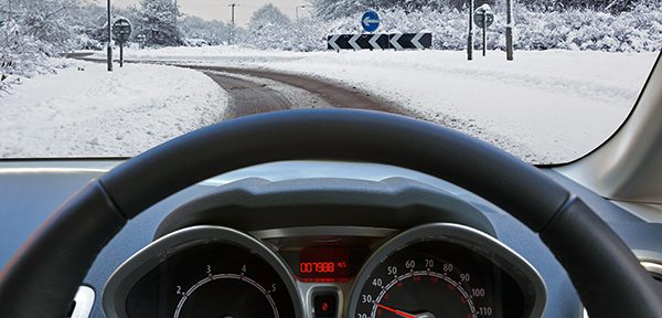Snowy weather through a driver's view