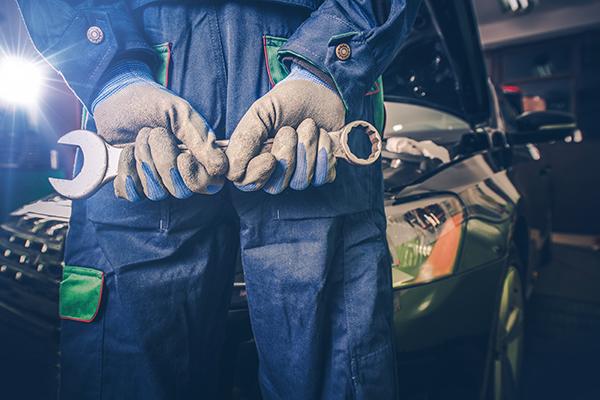 garage mechanic with spanner