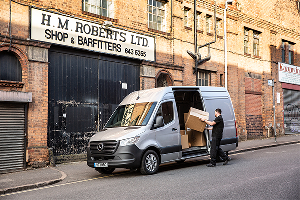 2019 Parking a man is unloading deliveries from a Mercedes-Benz Sprinter-23