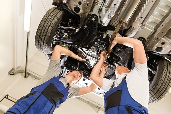 VOR mechanics in garage doing a service