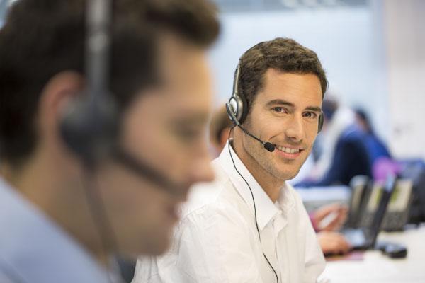 men answering calls