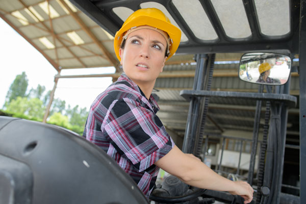 A lady reversing a forklift truck