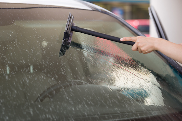 Windscreen being cleaned with a squidgy