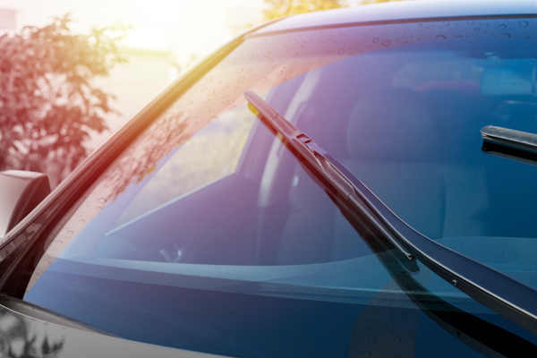 Front image of a car windscreen in the summer light