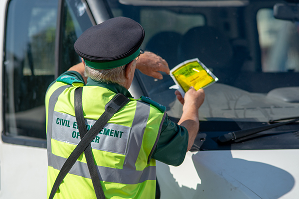 Penalty charge being issued by a warden
