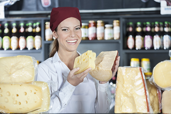 say 'cheese' to extra funding. shop assistant smiles holding cheese