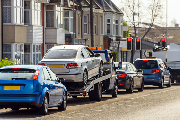 executive car being towed because it didn't have the right commercial insurance